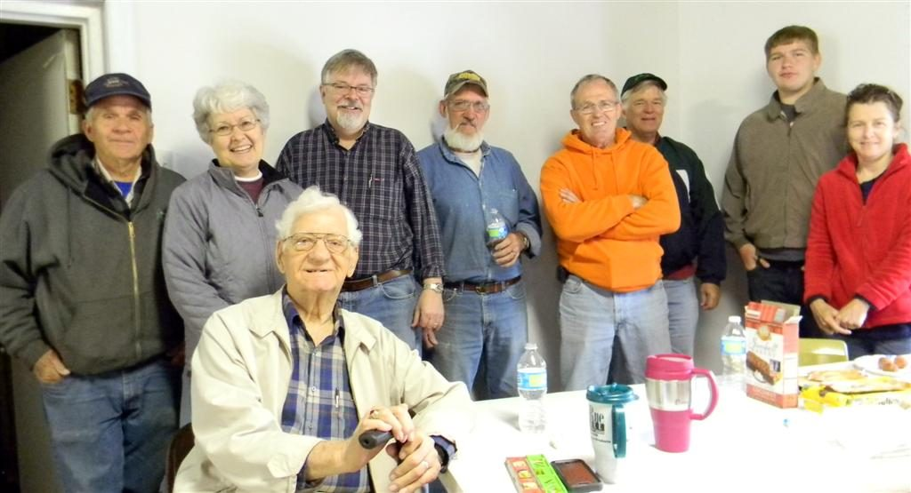COM members and other volunteers take a much deserved break. (Back row, left to right: Chuck & Shirley Ballard, Pastor Rob Porter, David Short, Denny Davis, Jerry McFerron, Ryan, Debbie Mcferron and Claude McFerron seated.)