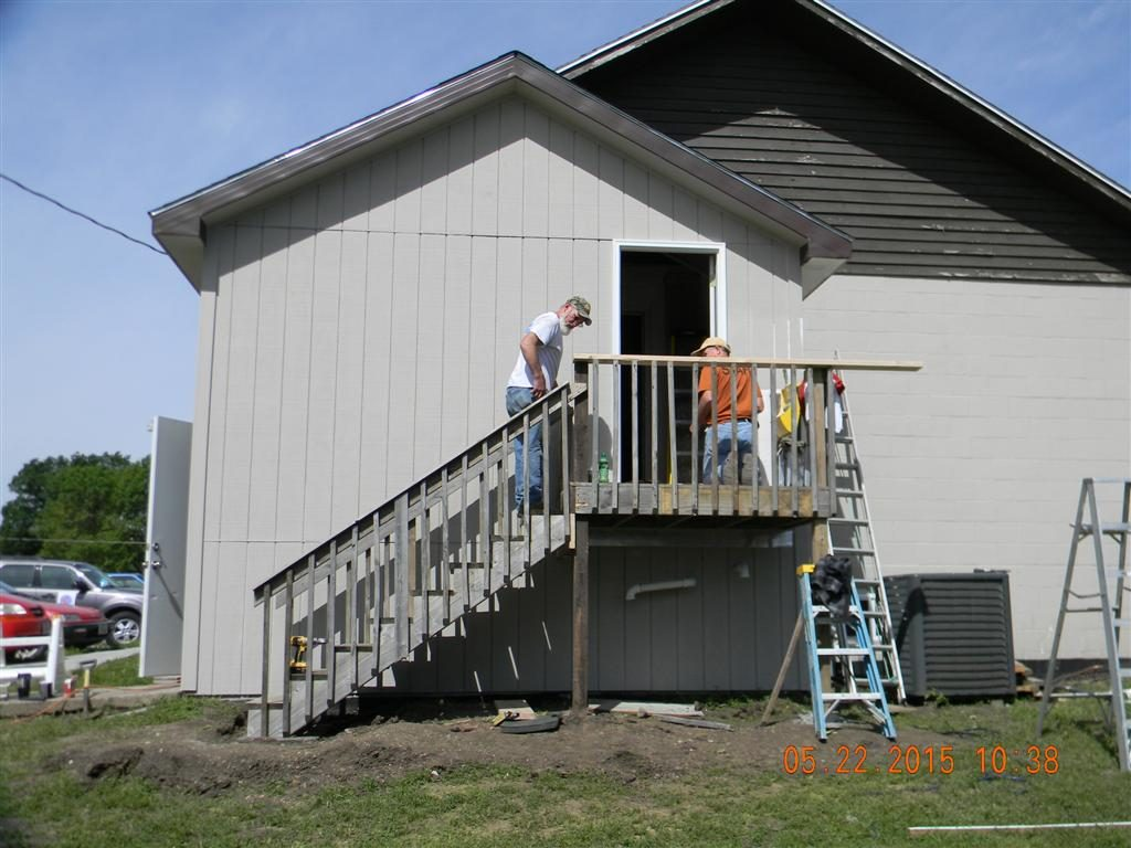 Installing stairs on the outside of the new addition.